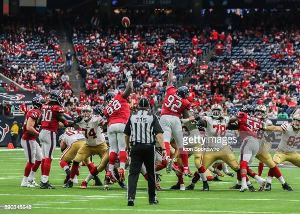 Houston Texans defensive line attempts to block a San Francisco 49ers extra point kick during the NFL game between the San Francisco 49ers and...