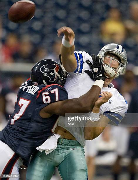 Houston Texans defensive tackle Malcolm Sheppard hits Dallas Cowboys quarterback Stephen McGee as he releases the ball in the second half of their...