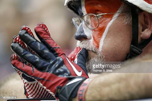 Houston Texans fan prays for the Houston Texans to score in overtime against the Seattle Seahawks on September 29 2013 at Reliant Stadium in Houston...