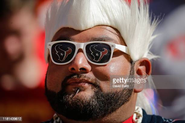 Houston Texans fan wearing the team's logo sunglasses smiles during the game against the Kansas City Chiefs at Arrowhead Stadium on October 13 2019...