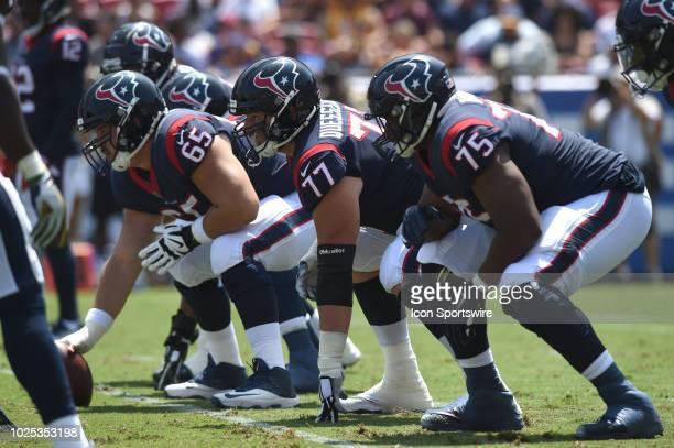 Houston Texans Greg Mancz , Houston Texans David Quessenberry , and Houston Texans Martinas Rankin line up for the snap during an NFL preseason game...