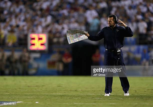 Houston Texans head coach Gary Kubiak gives instructions from the sideline against the San Diego Chargers at Qualcomm Stadium on September 9 2013 in...