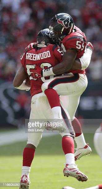Houston Texans linebacker Morlon Greenwood and Houston Texans linebacker DeMeco Ryans celebrate a fumble recovery The Houston Texans defeated the...