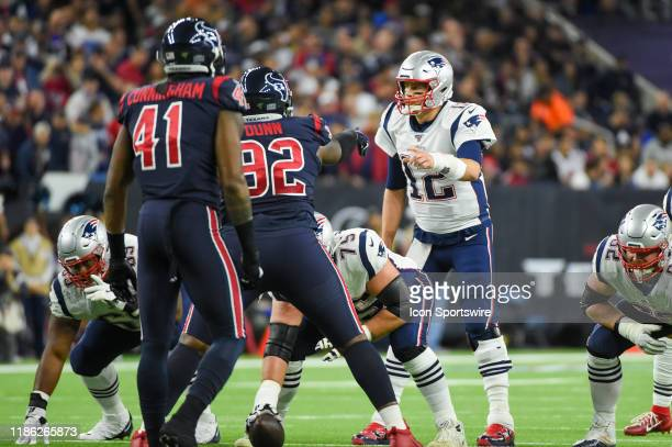 Houston Texans nose tackle Brandon Dunn and New England Patriots quarterback Tom Brady point at each other during the football game between the New...