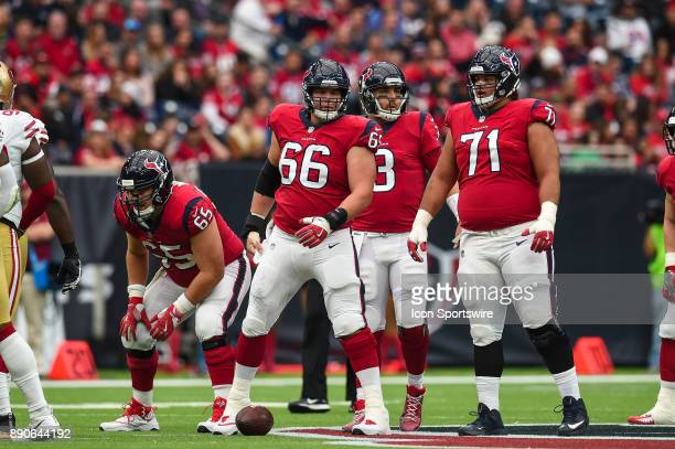 Houston Texans offensive guard Greg Mancz center Nick Martin and offensive guard Xavier Su'aFilo get ready for a play during the football game...