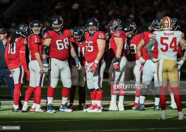 Houston Texans offensive line looks to the sideline for instructions during the NFL game between the San Francisco 49ers and Houston Texans on...