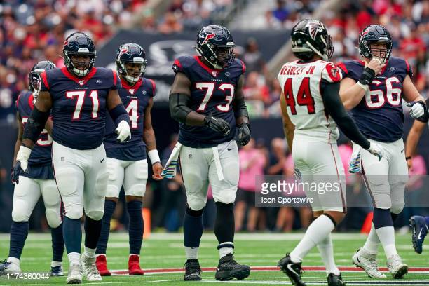 Houston Texans offensive tackle Tytus Howard offensive guard Zach Fulton and center Nick Martin walk up to the line during the NFL game between the...