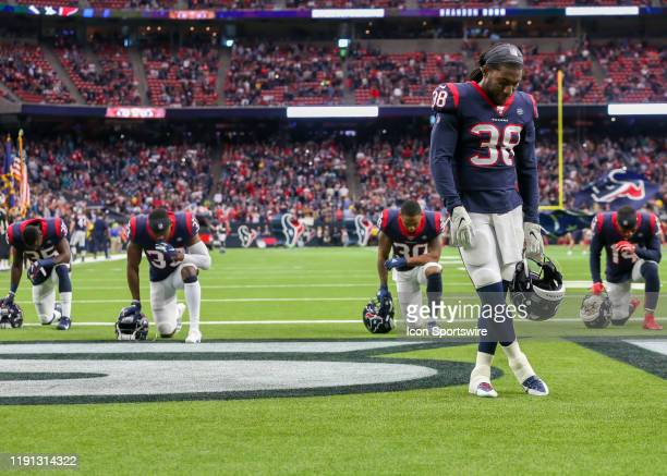 Houston Texans players take a moment of prayer during the football game between the Tennessee Titans and Houston Texans on December 29 2019 at NRG...