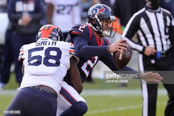 Houston Texans quarterback AJ McCarron is pressured by Chicago Bears inside linebacker Roquan Smith during the second half at Soldier Field on...