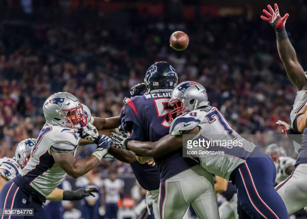 Houston Texans quarterback Brandon Weeden gets sacked by New England Patriots defensive lineman Adam Butler during the NFL preseason game between the...