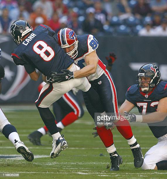 Houston Texans' quarterback David Carr is hit by Buffalo Bills' Chris Kelsay as he releases the ball during first half game at Reliant Stadium...