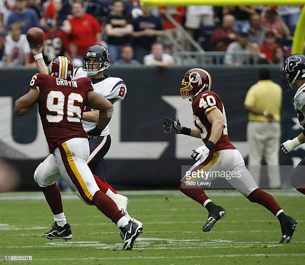 Houston Texans quarterback David Carr is pressured by Washington Redskins defensive tackle Cornelius Griffin and safety Adam Archuleta at Reliant...