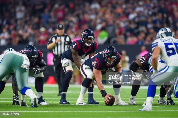 Houston Texans quarterback Deshaun Watson gets ready to take a snap from center Nick Martin during the game between the Dallas Cowboys and Houston...