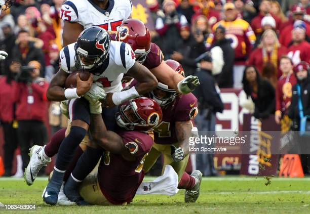 Houston Texans quarterback Deshaun Watson is brought down by Washington Redskins defensive end Jonathan Allen in the second half on November 18 at...