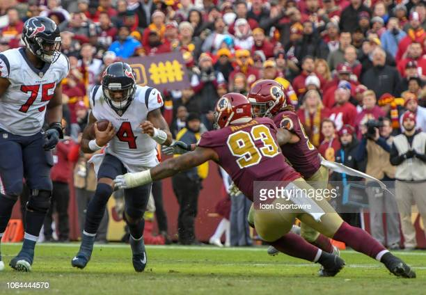 Houston Texans quarterback Deshaun Watson is brought down by Washington Redskins defensive end Jonathan Allen on November 18 at FedEx Field in...