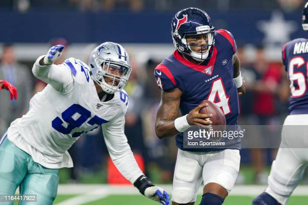 Houston Texans quarterback Deshaun Watson is chased Dallas Cowboys defensive end Taco Charlton during the preseason game between the Houston Texans...