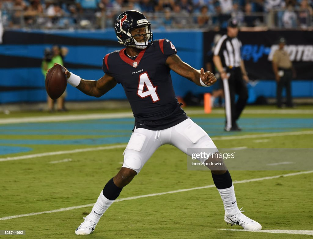 Houston Texans quarterback Deshaun Watson (4) passes during the preseason game between the Houston Texans and the Carolina Panthers on August 9, 2017 at Bank of America Stadium in Charlotte, NC.