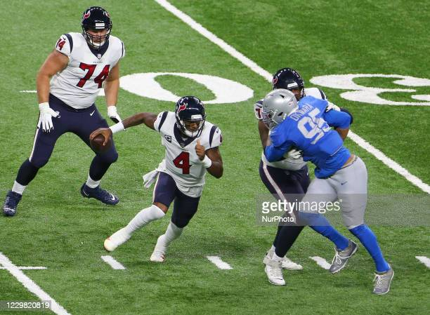 Houston Texans quarterback Deshaun Watson runs with the ball before passing under the pressure of Detroit Lions defensive end Romeo Okwara during the...