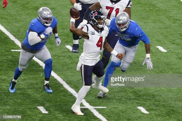 Houston Texans quarterback Deshaun Watson throws the ball under the pressure of Detroit Lions defensive end Romeo Okwara and Detroit Lions defensive...