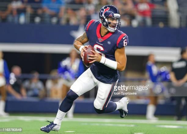 Houston Texans quarterback Jordan Ta'amu-Perifanos rolls out for a pass during the preseason game between the Houston Texans and Dallas Cowboys on...