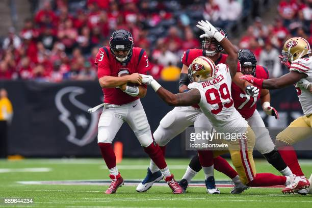 Houston Texans quarterback Tom Savage avoids San Francisco 49ers defensive tackle DeForest Buckner during the football game between the San Francisco...