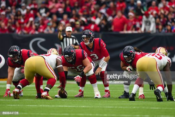 Houston Texans quarterback Tom Savage gets ready to take a snap from center Nick Martin during the football game between the San Francisco 49ers and...