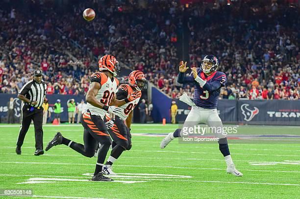 Houston Texans Quarterback Tom Savage releases an incomplete pass as Cincinnati Bengals Defensive End Michael Johnson and Cincinnati Bengals...