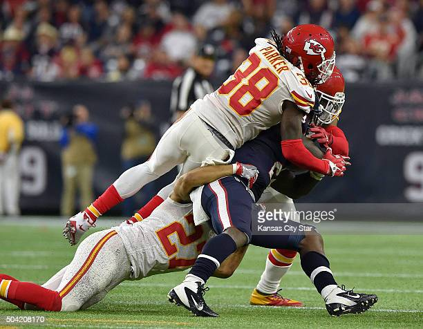 Houston Texans running back Alfred Blue is stopped in the third quarter by the Kansas City Chiefs defense during the AFC Wild Card game on Saturday...