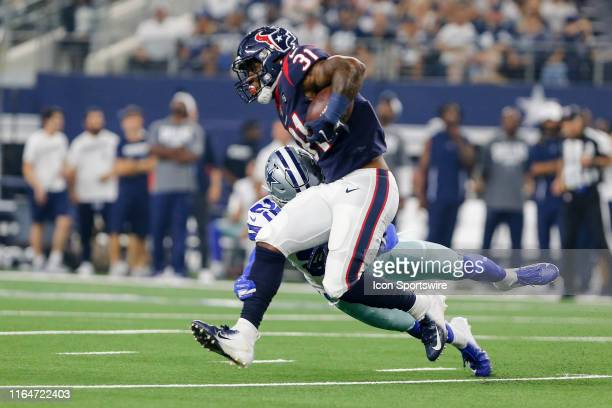 Houston Texans running back Karan Higdon gets tackled by Dallas Cowboys free safety Xavier Woods during the game between the Dallas Cowboys and the...