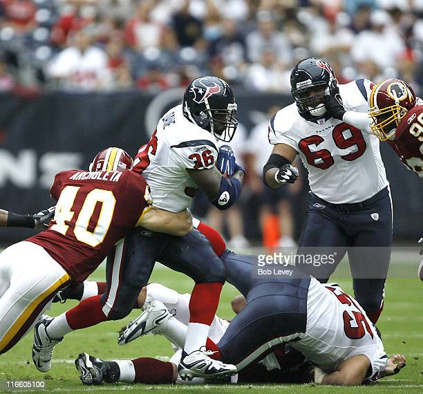 Houston Texans running back Ron Dayne is tackled by Washington Redskins safety Adam Archuleta at Reliant Stadium Houston Texas September 24 2006