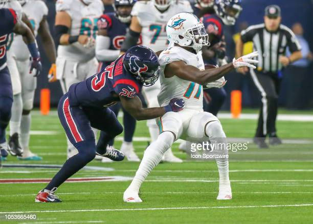 Houston Texans strong safety Kareem Jackson tackles Miami Dolphins wide receiver DeVante Parker during the football game between the Miami Dolphins...