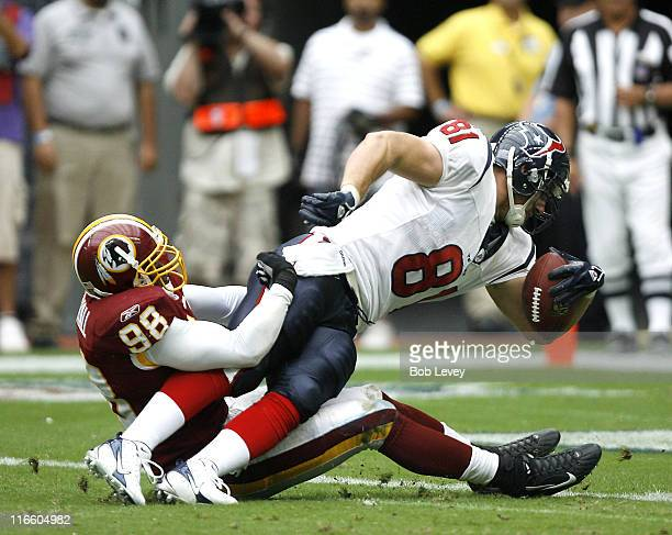 Houston Texans tight end Owen Daniels stretches over the goal line for a touchdown in the third quarter as Washington Redskins linebacker Lemar...
