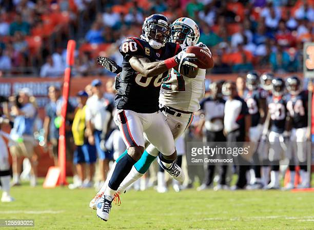 Houston Texans wide receiver Andre Johnson attempts to make a reception against Miami Dolphins cornerback Vontae Davis during a game at Sun Life...