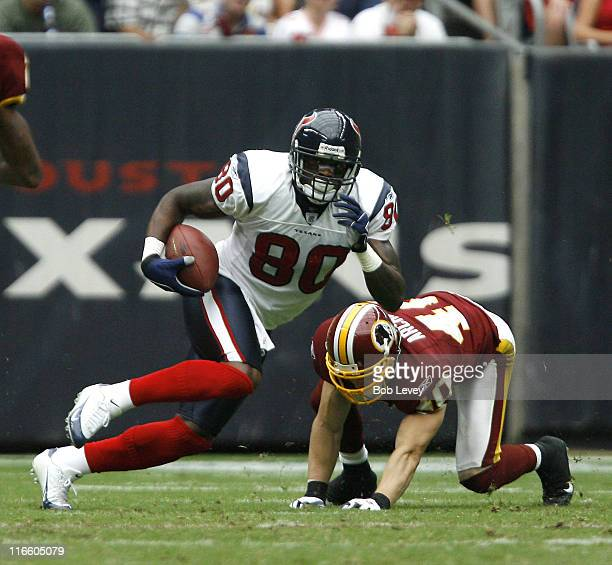 Houston Texans wide receiver Andre Johnson gets arounnd Washington Redskins safety Adam Archuleta during second half action between the Houston...