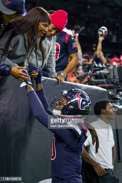 Houston Texans wide receiver DeAndre Hopkins holds hands with his mother after a touchdown catch during the game between the Indianapolis Colts and...