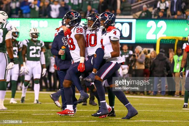 Houston Texans wide receiver DeAndre Hopkins is carried off the field by teammates Houston Texans running back Alfred Blue and Houston Texans...