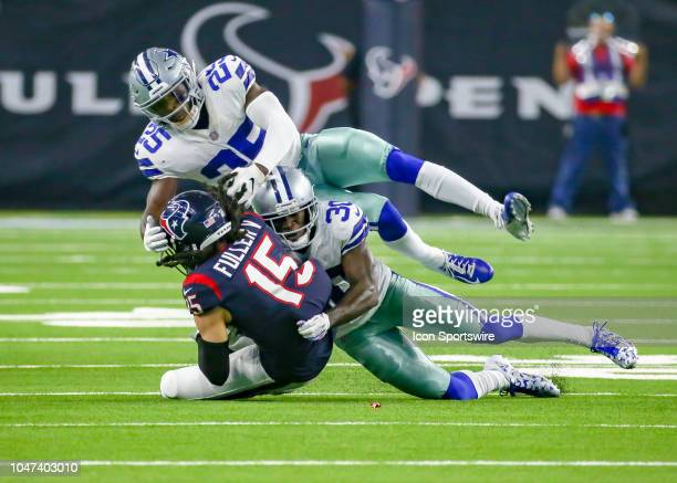 Houston Texans wide receiver Will Fuller gets tackled by Dallas Cowboys free safety Xavier Woods and Dallas Cowboys cornerback Anthony Brown during...