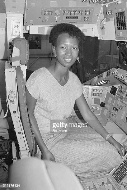 Mae C Jamison a Los Angeles doctor who is the first black female named to the astronaut trainee program sits in a space shuttle crew trainer at the...