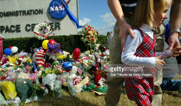 Houston Texas NASA headquarters aftermath of Space shuttle Columbia tradgedy Alexis Maroul 6 and her dad John Maroul of Houston pay their respects at...