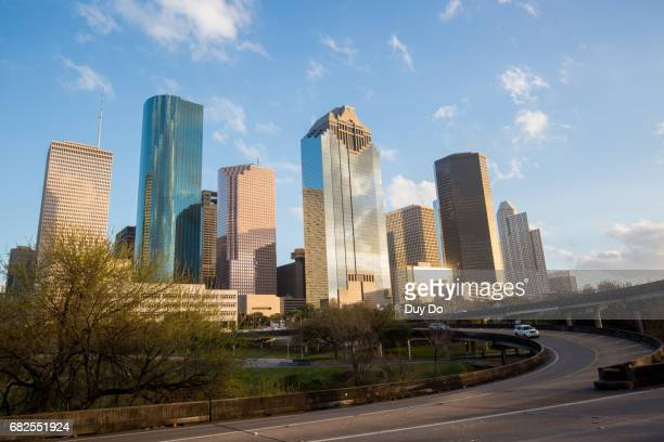 Houston Texas Skyline with modern skyscrapers and blue sky view from Bayou park