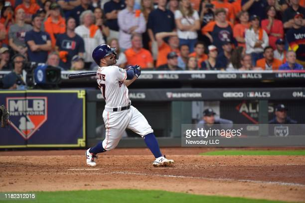 Houston Astros' second baseman Jose Altuve hits a 2-run home run to win the game in the ninth inning in Game 6 of the ALCS against the New York...