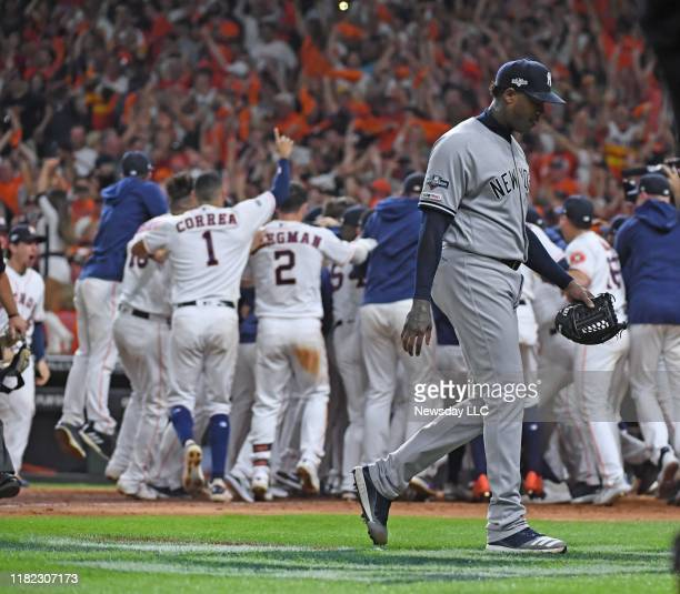 New York Yankees relief pitcher Aroldis Chapman walks off as the Houston Astros second baseman Jose Altuve hits a tworun home run in the ninth inning...