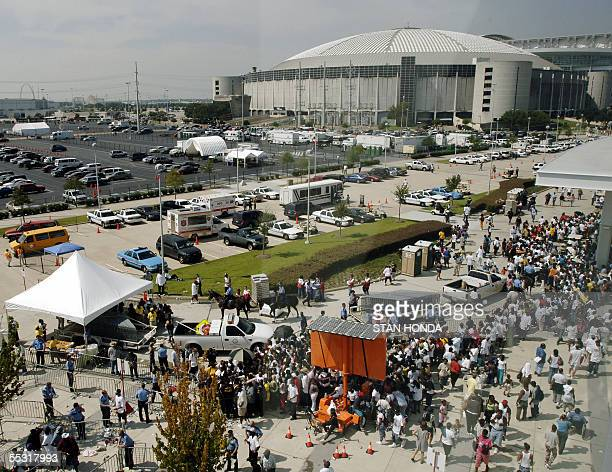A crowd of Hurricane Katrina evacuees line up to receive a debit card from the Red Cross 08 September outside the Reliant Center in Houston Texas...