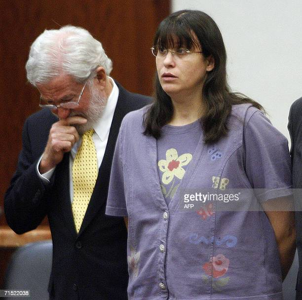 Houston, UNITED STATES: Andrea Yates and her attorney George Parnham listen as the verdict is read in her murder retrial 26 July in Houston, Texas....