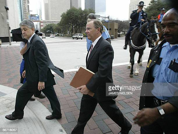Former Enron CEO Jeffrey Skilling and his attorney Daniel Petrocelli leave the Bob Casey Federal Court House for the lunch break on the third day of...