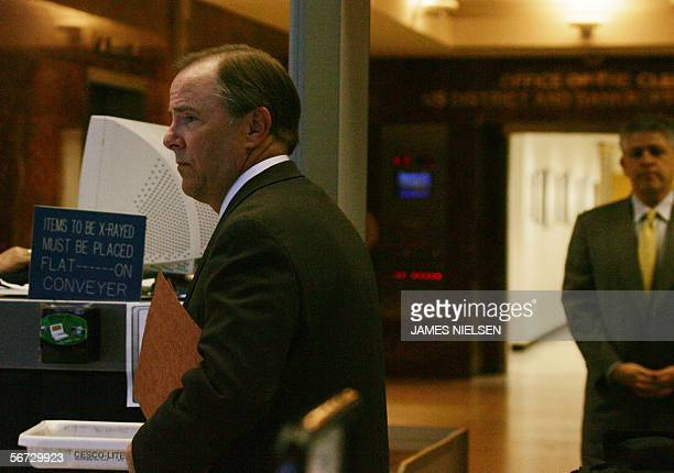 Former Enron CEO Jeffrey Skilling and his attorney Daniel Petrocelli pass through the security check point at the Bob Casey Federal Court House for...