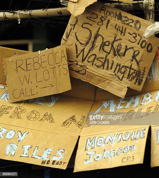 Hand written signs at the message board for Hurricane Katrina evacuees 06 September are on the floor of the Astrodome in Houston Texas where people...