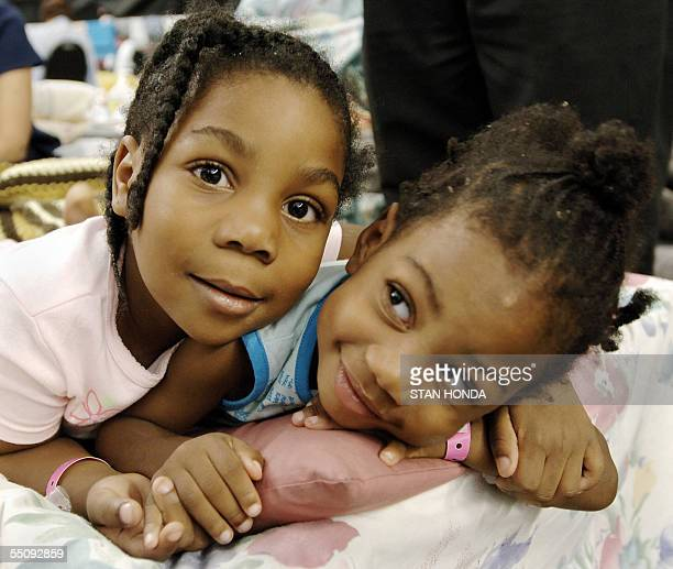 Hurricane Katrina evacuee Nale Jackson and her sister Jai'Lynn Butler lie on their bed 06 September on the floor of the Astrodome in Houston Texas...