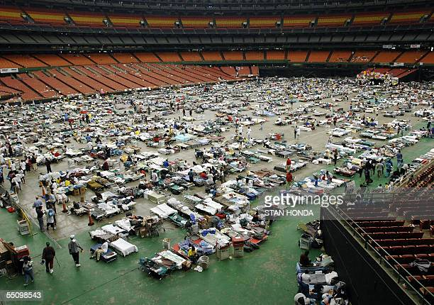 Hurricane Katrina evacuees 06 September are shown on the floor of the Astrodome in Houston Texas Evacuees number 16000 in the Astrodome with an...