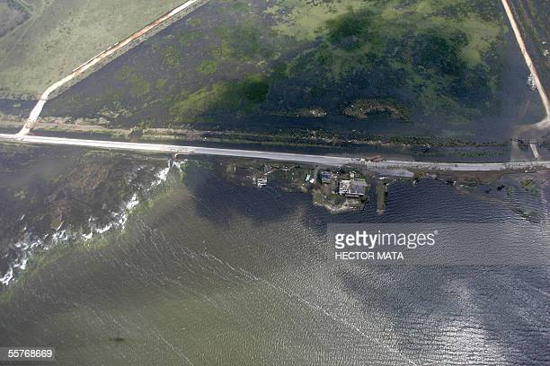 This aerial view shows part of the coastline after Hurricane Rita near Port Arthur Texas 25 September 2005 Hurricane Rita pounded the US Gulf Coast...